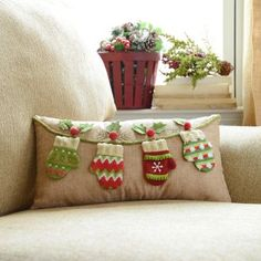 Switch out your pillows for the holiday season! We love the Knit Mittens Accent Pillow! #Kirklands #holidaydecor #KirklandsHoliday
