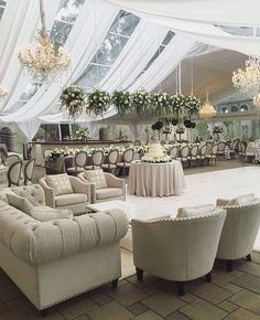 We love this neutral-hued and greenery-filled tented reception space by Viva Bella Events. This lounge area is the perfect spot for guests to mingle during your reception. #repost | Draping: Fitz the Occasion | Florals:Robinwood Flowers | WedLuxe Magazine | #wedding #luxury #weddinginspiration