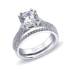 Nice wedding set that shows off it's round brilliant diamond.  Marshall Jewlery