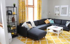 I cannot get enough of the gray and yellow color combination in this living space. So homey and warm! /ES