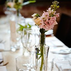 @mikaellabridal   Mikaella Bride Katy wore Style 1661 on her wedding day. #centerpiece #weddingcenterpiece #flowers #weddingflowers #pink #pinkflowers #rustic #rusticcenterpiece #rusticwedding #snapdragons #roses #realwedding #weddinginspiration