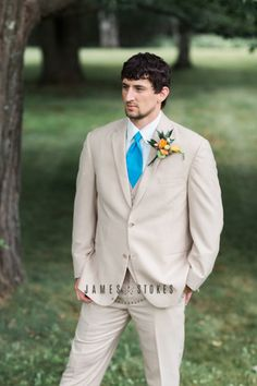 Wisconsin country wedding - groom - country styled groom - blue tie - khaki groom suit - Wisconsin wedding photographer - groom attire - www.james-stokes.com