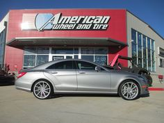 Vossen CVT Wheels in Metallic Gloss Silver on a Mercedes-Benz CLS550. 22x9 front with 245/30-22 tires and 22x10.5 rear with 295/25-22 tires.  http://www.americanwheelandtire.com/