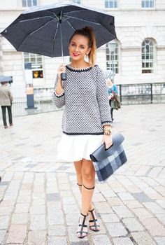 White skirt and checked bag.