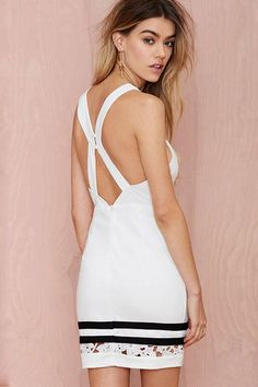 Turn heads this season in this chic white bodycon dress with black stripes, lace contrast! We're loving this halterneck dress with a cross back bodycon finish which will be sure to give you a killer silhouette. Style with some strappy nude heels and clutch to finish your look.