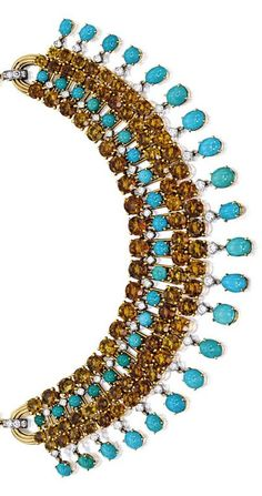 CITRINE, TURQUOISE AND DIAMOND NECKLACE, CARTIER, PARIS. The graduated fringe necklace composed of links, each set with circular-cut citrine and turquoise, embellished by brilliant-cut diamonds, completed by a gold link-chain, length approximately 385mm;