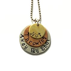 """Hamilton """"Not Throwing Away My Shot"""" Necklace Tri-Layer brass, copper, and aluminum necklace with an 18"""" aluminum chain. Each necklace comes in an organic pouch, ready for gift giving! Perfect for fan"""