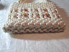 Materials & Supplies Needed To Make Macrame Purse 110 yds of BRAIDED macrame cord (or braided) 20 one inch wooden beads beads front, 10 beads back) knotting board or ceiling tile T-… Macrame Purse, Macrame Cord, Macrame Knots, Macrame Bracelets, Clove Hitch Knot, Macrame Bracelet Tutorial, Baby Girl Crochet, Macrame Projects, Glue Crafts
