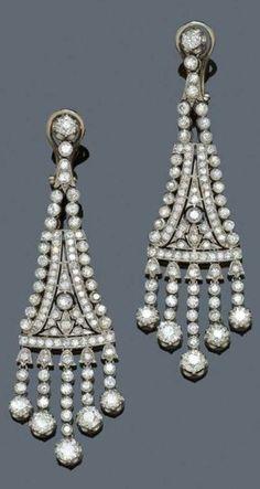 A PAIR OF ART DECO DIAMOND PENDANT EARRINGS, CIRCA 1930. Each consisting of a…