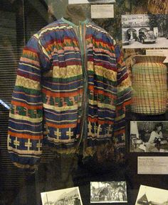 This is an exceptional example of Seminole patchwork clothing -- a  man's shirt.  At right in the background is a coiled sweetgrass  basket.  These are exhibits from Ah Tah Thi Ki -- the wonderful  Seminole museum near Clewiston, Florida.