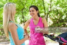 Stock Photo : Moms talking together while jogging with strollers in park