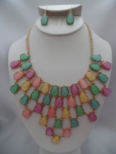 Visit: hipandcoolcliponearringstwo.com and receive up to 70% off. Clip on pink multi colored statement necklace and earring set  $17.99 http://hipandcoolcliponearringstwo.com