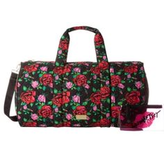Betsey Johnson Black Floral Stayer Quilted Weekend Carry your belongings in style w/ this chic weekender bag. Heart stitched quilted black floral bag is fabricated from a cotton-poly blend, goldtone brand logo and hardware. Dual carry handles and removable/adjustable crossbody strap. Includes a clear pink cosmetic purse w/ brand logo. Bag has top zip closure and faux leather flat base. Interior is lined with signature brand fabric- nice large size- back wall zip pocket and three slip…