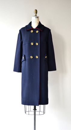 Vintage 1960s Lou Fritzel navy blue wool coat with military inspiration, goldtone double breasted buttons, button trimmed pockets, back strap and red lining.  --- M E A S U R E M E N T S ---  fits like: medium shoulder: 16 bust: 40 waist: up to 38 hip: up to 43 sleeve: 21.5 length: 39 brand/maker: Lou Fritzel condition: excellent  ➸ More vintage coats http://www.etsy.com/shop/DearGolden?section_id=5800175  ➸ Visit the shop http://www.DearGolden.etsy.com _____________________  ➸ instagram…