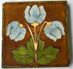 Art Nouveau tile with blue flowers
