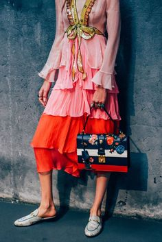 We love this outfit combo with Gucci's flower print bag.