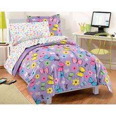 This ultra-soft microfiber bedding set includes sheets and features whimsical flowers and fluttering butterflies in an array of multi-colors. The printed fabric comforter and sham reverse to a solid p