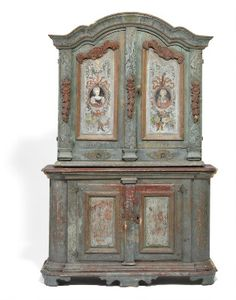 A Swedish Allmoge cupboard, blue painted and decorated with flower paintings. 18th century. H. 222 cm. W. 145 cm. D. 58 cm.
