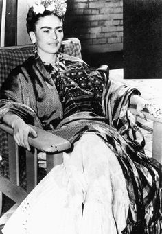 Frida Kahlo considered herself an ambassador of Mexican culture and national independence. What do you notice in this photograph that may symbolize 1930s Mexican national identity? [Frida Kahlo in San Francisco / 1939. Photograph. Encyclopædia Britannica ImageQuest. Web. 27 Jul 2015. http://quest.eb.com/search/109_122506/1/109_122506/cite