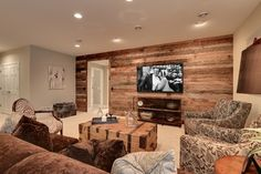 Planked wood wall.  Use pallets to create this look.  Gives warmth and cozy feel to the room.