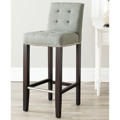 Give your bar area a sophisticated flair with these grey bar stool chairs. Upholstered in classic grey linen fabric, these birch wood stools will add the finishing touch to your decor. A lovely espresso finish completes these stools.
