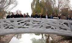 The world's first 3D-printed pedestrian bridge is a micro-reinforced concrete structure created by fusing layers of sand using a massive d-shaped 3D printer.