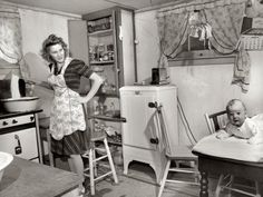 "December 1943. ""Lynn Massman, wife of a second class petty officer who is studying in Washington, does the washing every morning.""  Medium-format negative by Esther Bubley for the Office of War Information."
