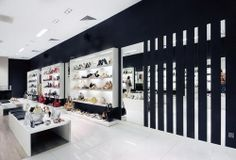 A retail store design. Para, a shoe store design, by A+D Poland. The idea of this shoe store design is to have a chic, elegant and comfort place to serve its customers that has a wide range of ages. This retail store design adopted two colors tone for its interior.