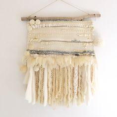 Beautiful woven Wall hanging using 100% wool, merino, feathers, twine and Pom poms. Made in my studio in Avalon, Australia. Measures approx 1m x 1.3m!  Instagram @julienicholsonartist Www.julienicholson.com  #wallhanging #weaving #julienicholsonartist