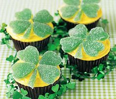 Shamrock Cupcakes:  1 can (16 ounces) vanilla frosting  24 cupcakes  96 green candy spearmint leaves  Sugar,Yellow icing color-  Tint frosting yellow. Frost cupcakes. Roll out leaves on sugared surface. Using a 1-inch heart-shaped cookie cutter, cut out 96 hearts. Arrange 4 hearts on each cupcake for clover. Make stems from candy scraps.