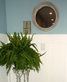 Porthole mirror from Target and vintage upcycled plant stand as end of the hall vignette - Mixing Big Box Retail with Vintage and Upcycled Finds at thehappyhousie