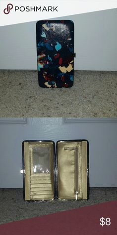 Wallet Navy blue with floral print and a glossy finish. Gold interior. Clips shut Bags Wallets