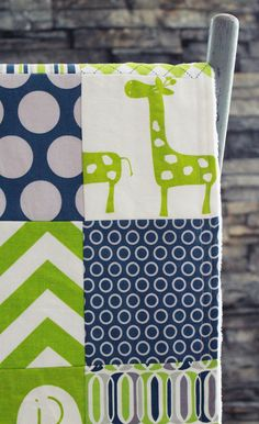 Baby Blanket, Modern Baby Quilt - Green Giraffe via Etsy. So cute and pretty simple to make.