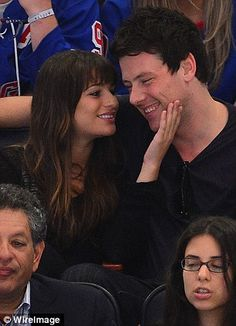 Glee's Lea Michele and Cory Monteith are more interested in each other than the ice hockey as they indulge in a rinkside PDA (I know love them more in real life than on the show)