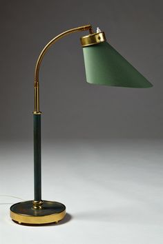 Table lamp designed by Josef Frank for Svenskt Tenn, Sweden. 1940's. - Lacquered brass, polished brass and cotton.