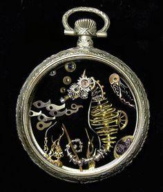Sue Beatrice Utilizando piezas de maquinaria de antiguos relojes de bolsillo, la artista estadounidense Susan Beatrice, con sede e...