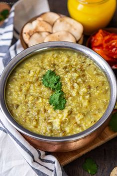 Punjabi Khichdi - vegan and gluten free Indian porrdife made of split green gram (green moong dal) and rice and favored with Indian spices. #indianfood #khichdi #dalkhichdi #glutenfreerecipe #instantpotrecipe #onepotmeal #punjabifood #northindianfood #veganindianfood #vegetarianindianfood