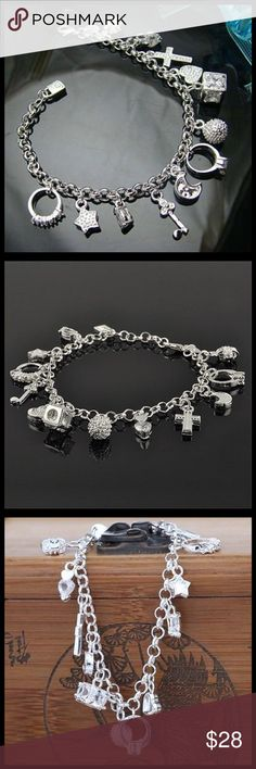 Charm Bracelet Silver tone 13 charms charm bracelet. Girly charms and Spritual charms make for a perfect gift. Jewelry Bracelets
