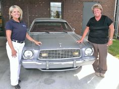 THIS JUST IN! … We discovered that our business manager, Sharron Miller, has been here 33 years as of today!  Congratulations and THANK YOU, Sharron!  To commemorate the occasion, Sharron & Kay posed by a model at the dealership which has a year close to their combined years (73) of experience: a '74 Ford Mustang!  Now that's classing-up a classic even more!!