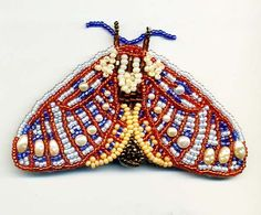 Butterfly of Pale Blue and Orange Beads