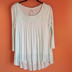 NWT LC Lauren Conrad Shirt NWT LC Lauren Conrad Shirt. Hi-low, mint green (color is more vibrant in person), 3/4 sleeves, lace design on top. 100% Rayon. LC Lauren Conrad Tops
