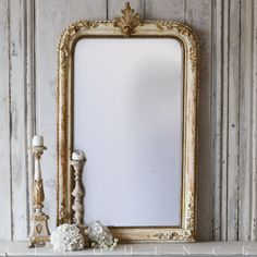 Eloquence, Inc. Antique French Mirror Gorgeous Antique Floral mirror with leaf carving at crest and incredible sculptural details adorning frame. Wonderful worn gold finish back to reveal gesso and plaster.