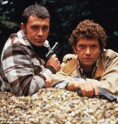 Lewis Collins as Bodie and Martin Shaw as Doyle in The Professionals