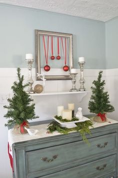 I love this green bureau from HomeGoods! Perfect for decorating a Christmas vignette. (sponsored) Cake stand, trees and runner from HomeGoods.
