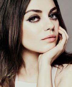 Mila Kunis. The make up reminded me of 60 mod posh...