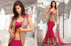Magenta. It's so beautiful I love there collection ♥  Hindu / indian bride Wear saree, lehenga, choli from seasonsindia. the model is Neha Dalvi or Maria Sokolovski