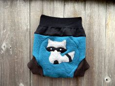 100% recycled wool soaker cover,diaper cover. Medium weight wool.Great for day or night time use. teal, brown and black color soaker cover with sneaky
