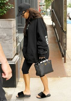 Chic: Though she was dressed down, Kim still showed off her fashion sense, carrying a stylish, black leather handbag