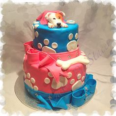 Dog themed birthday cake. Put a fish on the other side, take the dog and accessories off the top, add cute Schleich puppy and kitten figurines, and make the colors pink and purple. Wa-lah, gorgeous puppy/kitten themed cake