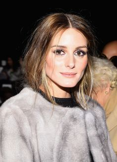 Nailing front row chic at the Dennis Basso show, Olivia Palermo pairs her fashionable hair-tuck with smoked out eyes and a nude lip.